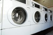 self-service laundry facilities concept - washing machines at laundromat poster