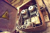 Overloaded electrical circuit causing electrical short and fire. Old electric power supply boxes. Industrial background. Overloaded electrical circuit causing fuse to break. poster
