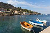 La Azohia Murcia Spain with boats moored by the sea, the village located near La Isla Plana and between Puerto de Mazarron and Cartagena poster