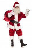 merry saint nick holds his red sack while ringing bell and standing on white background, full body picture poster