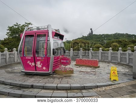 Ngong Ping, Hong Kong, May 2018 - View Of A Ngong Ping 360 Cable Car With The Tian Tan Big Buddha In