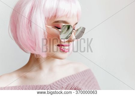 Studio Shot Of Laughing Dreamy Young Woman Wears Sparkle Sunglasses And Peruke. Indoor Close-up Port