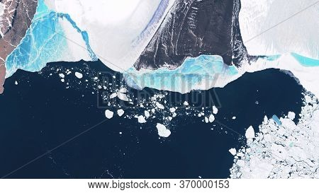 Glacier In Greenland, Blocks Of Ice Floating In The Ocean, Seasonal Changes In Glaciers. Contains Mo