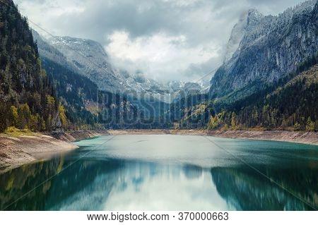 Alpine Lake With Dramatic Sky And Beautiful Mountains. Unesco Heritage Site. Gosausee, Tirol, Austri