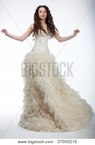 Sensual Bride In Lush White Nuptial Dress Standing
