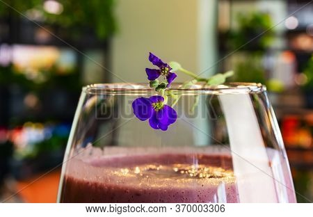 Blueberry Cocktail In A Glass On A High Leg