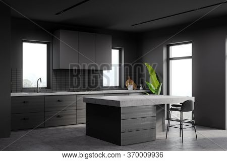 Corner Of Stylish Kitchen With Gray And Tiled Walls, Concrete Floor, Countertops, Bar With Stools An