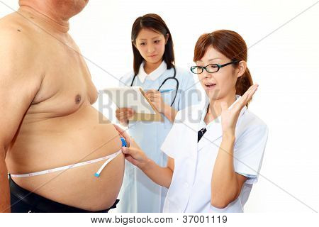 Woman doctor with a medical examination in obese patient