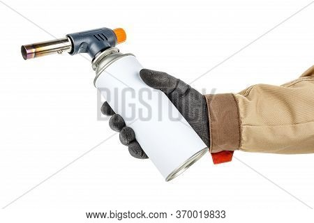 Large Welding Butane Torch With White Gas Bottle In Worker Hand In Black Protective Glove And Brown