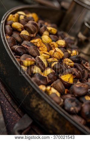 Roasting Chestnuts Over An Open Fire. High Quality Photo