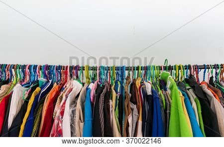 Hangers Hang On The Clothesline,clothes Of Various Colors Hanging On The Clothesline.