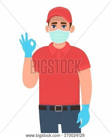 Delivery Man Or Courier In Mask And Gloves Showing Okay, Ok Sign. Person Gesturing Cool. Male Making