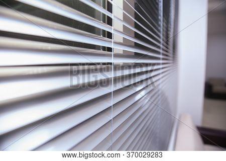 Sunlight Coming Through Venetian Blinds By The Window . Office Blinds. Modern Wooden Jalousie. Offic