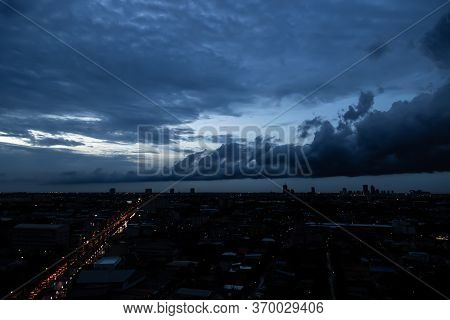 Dark Dramatic Sky At Night Time, It Is Monsoon With Stormy Gray Clouds Before Raining. It Is Strong