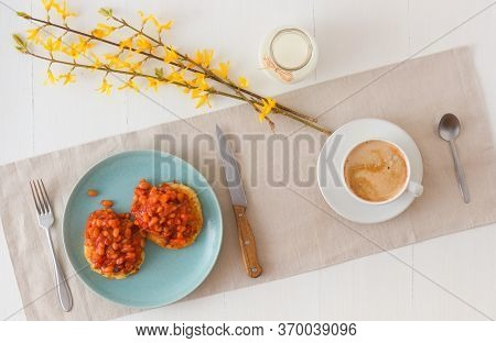 Table With Homemade Spicy Baked Beans With Bacon And Potato Crumpets, Cup Of Coffee, Glass Of Cream,