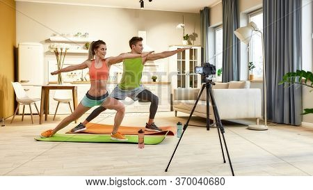 Full Length Shot Of Young Couple In Sportswear Recording Video Blog Or Vlog About Healthy Lifestyle