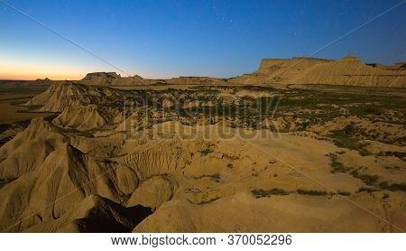 Desert Landscape Of Navarra In Moonlit Night. Spain