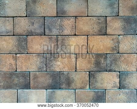Brick Wall Texture Background Material With With Wide Bricks. Wall Of Gray-brown Large Relief Brick.