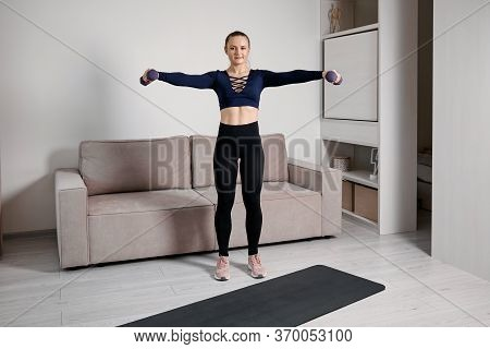 Fitness At Home. A Taut Slender Figure. The Girl Goes In For Sports