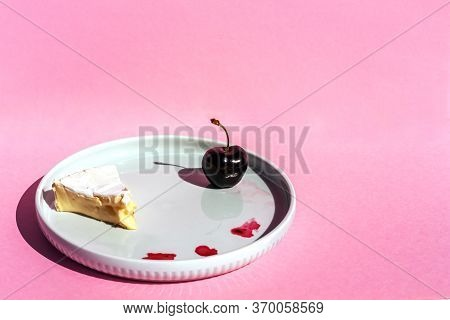 Cherry And One Slice Of Brie Cheese On The Plate On Red Background. Copy Space