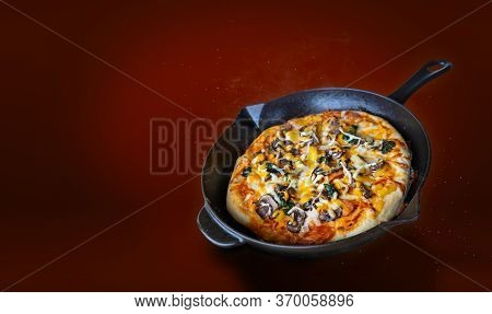 Delicious Hot Pan Pizza In Midair With Cheese, Pineapples, Spinach, Tomatoes, Artichoke And Sausages