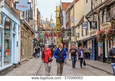 York, Great Britain - September 9, 2014: These Are Unidentified Tourists On One Of The Pedestrian St