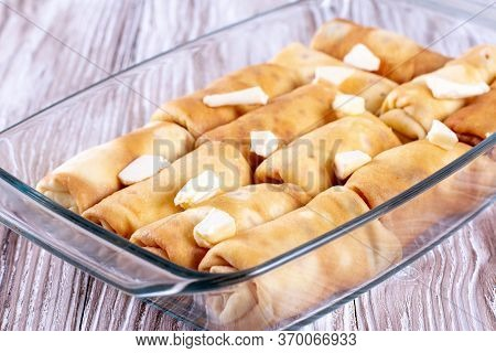 Pancakes With Filling In A Baking Dish. Russian Traditional Dish. Pancakes With Filling. Pancakes Wi