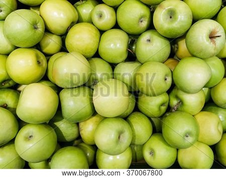 Solid Background Of Green Apples In A Crate. Many Organic Granny Smith Apples. Healthy And Affordabl