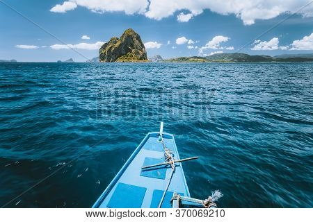 Boat Approaching Exotic Island On Tour Trip In Famous Archipelago Bacuit El Nido, Attractions Touris