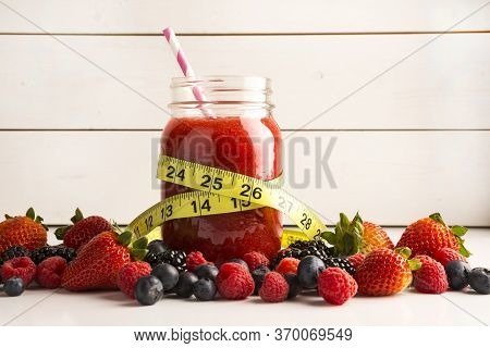 Mixed Berry Smoothie On White Rustic Background - Healthy Eating, Detox Or Diet Concept Surrounded B