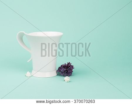 Fragile Still Life With Lilacs And White Cup.