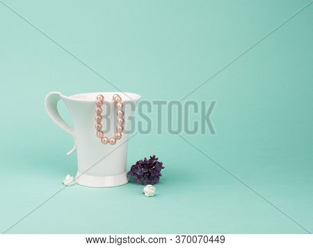 Delicate Composition. Spring Still Life With A Graceful Cup, Pearl And Lilac.