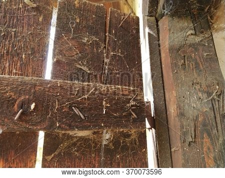 Old Wooden Doors. Iron Crookedly Boarded Up Nails. Wood Texture. Home-made Metal Door Fastening To T