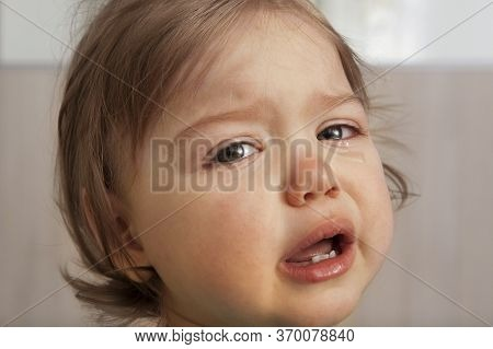Crying Baby With Tears In His Eyes. Children's Tantrums, Manipulations, Roar