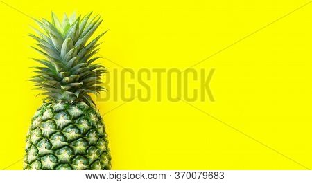 Single Whole Pineapple On Yellow Background. Copy Space