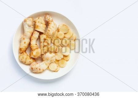 Fresh Galangal On A White Background. Top View