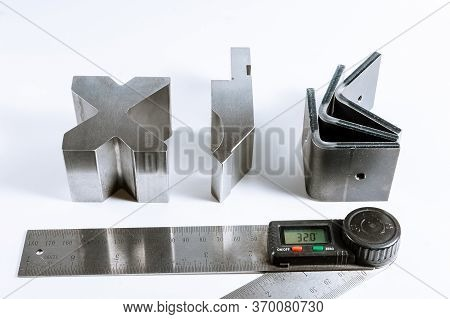 Sheet Metal Bending Tool And Equipment Isolated On A White. Bend Tools, Press Brake Punch And Die. D