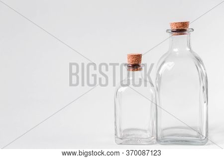 Glass Bottles With Cork On A White Background