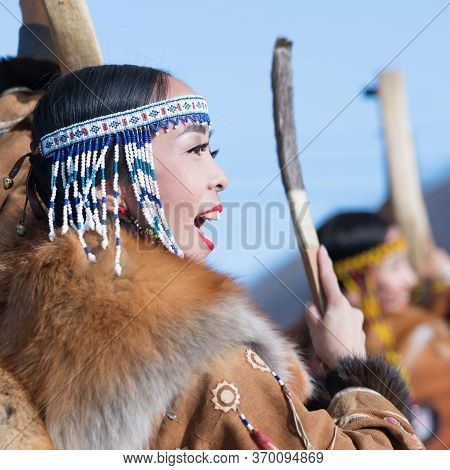 Female Dancing With Tambourine In Tradition Clothing Aboriginal People Of Kamchatka. Concert Celebra