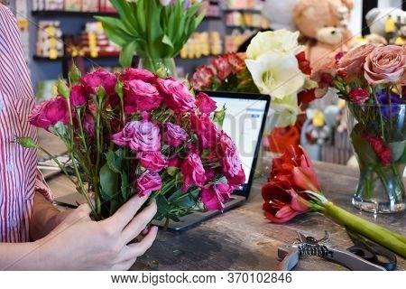 Flower Business. The Florist Makes A Bouquet. The Seller In Floristic Salon. Delivery Of Bouquets.
