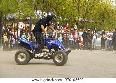 Moto Free Style Pilot Of Quad Bike Stunting On The Square - Pyatigorsk Russia Opening Of Moto Season