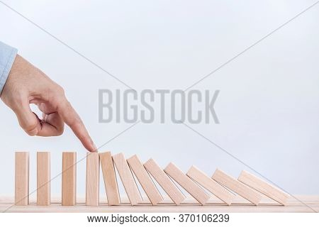 Businessman Hand Stopping The Domino Effect For Management And Solution , Concept Strategy And Succe