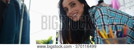 Woman Smiles While Modeling New Custom Clothes. Girl Smiles And Drawers Design Clothes She Wants To
