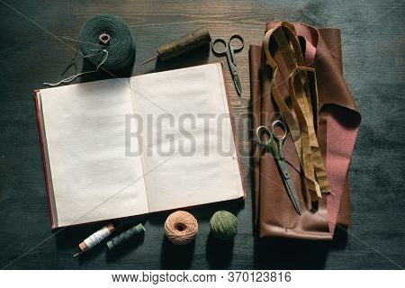 Old Sewing Accessory Flat Lay Background. Sewing Handbook Template.