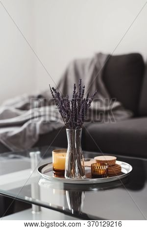 Coffee Table With Dried Lavender Flower And Aroma Candles On A Metal Tray. Living Room Decor. Minima