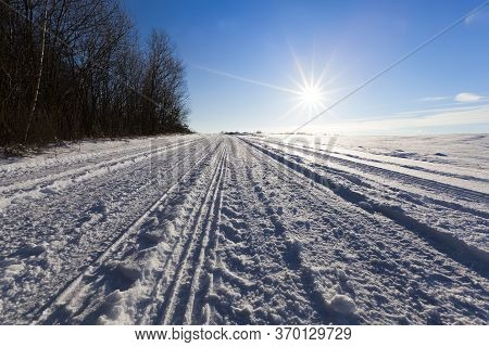 Winter Road With Ruts From Cars In Winter, Covered With Snow After Snowfall, Ruts From Cars On The R