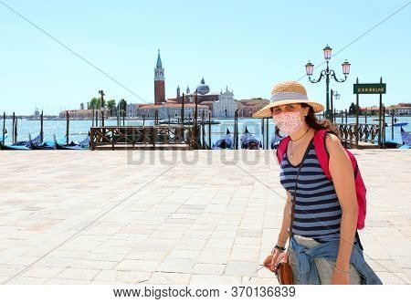 Pretty Woman With Surgical Mask In Venice In Italy During Lockdown By Corona Virus