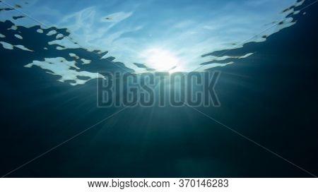 Underwater scene with sun rays