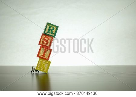Conceptual Image Of Risk And Uncertainty. Isolated Wooden Letter Block Stacked To Form Wrongly Spell