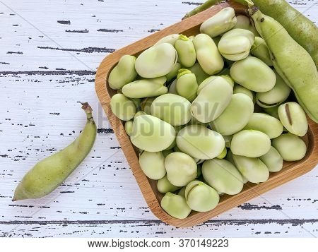 Closeup Of Raw Broad Bean Seeds On Wooden Table
